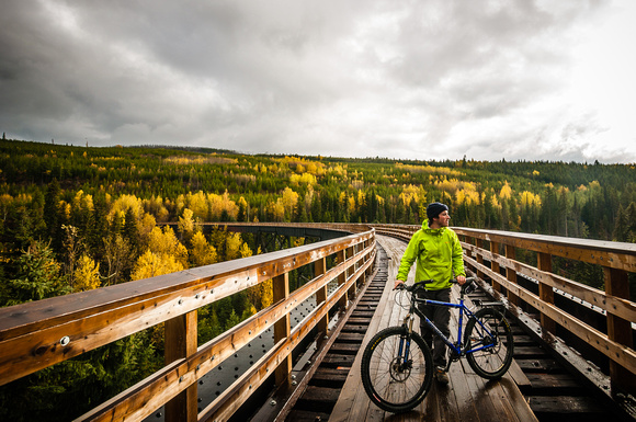 Biking on the KVR Trail in Myra Canyon Provincial Park.
