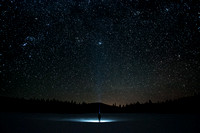 Stars shine bright from Nickel Plate as a hiker stands in solitude under a clear, winter night sky